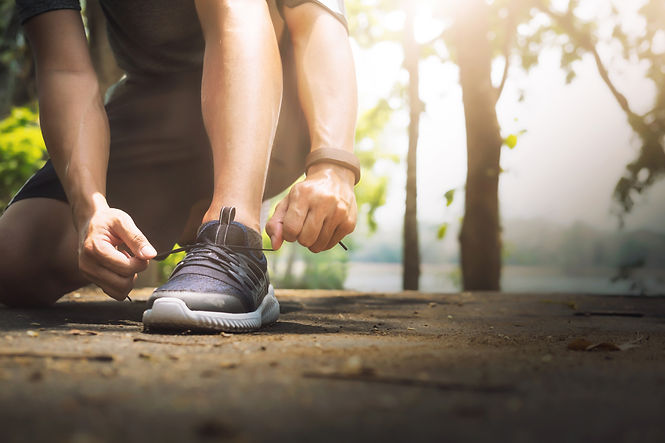 young-man-runner-tying-shoelaces.jpg