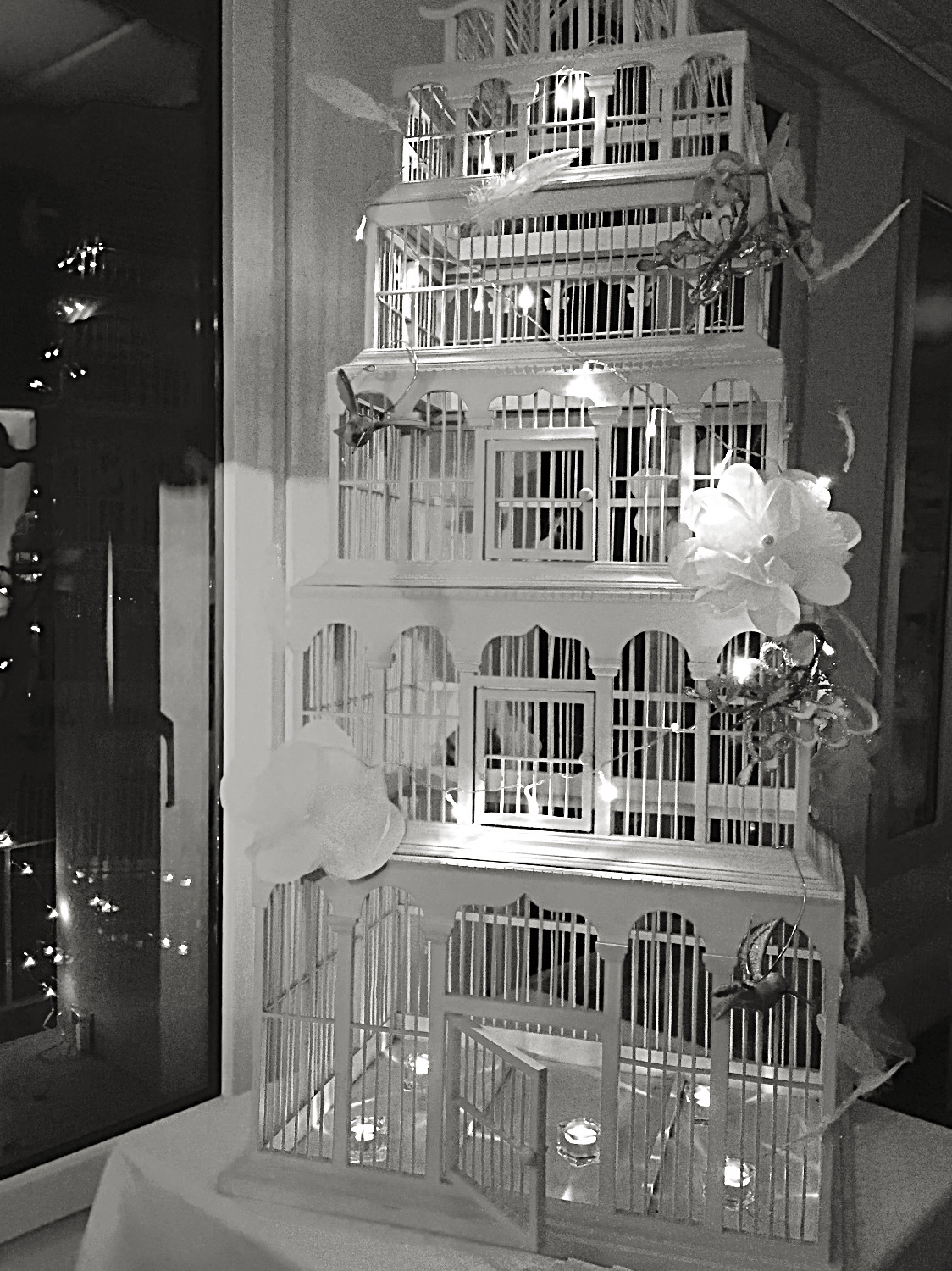 bird cage with fairy lights & candle
