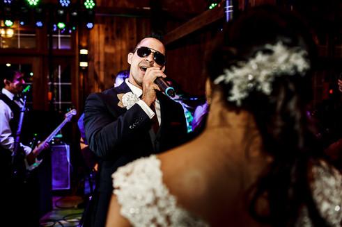 Groom serenading his bride