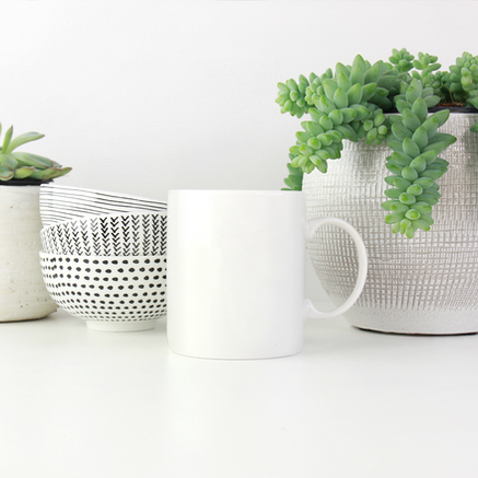 Creme Colored Planters with succulants, stack of small bowls, white coffe mug