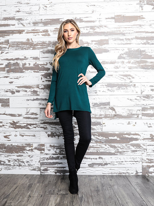 1169 Solid tunic top, relaxed fit, boat neckline, long sleeves.