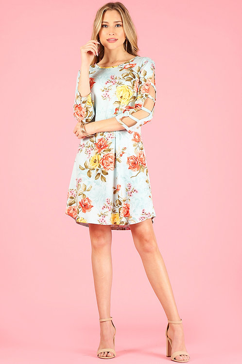 1278 Floral print dress with ladder detailed 3/4 sleeves.