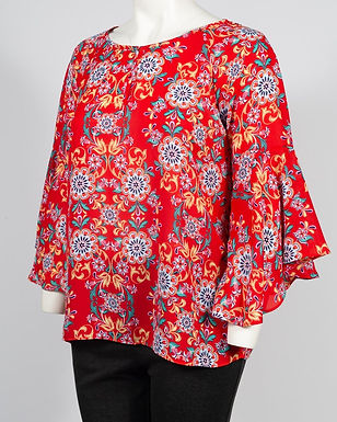 A vibrant, stylish semi-sheer blouse top which features asymmetrical