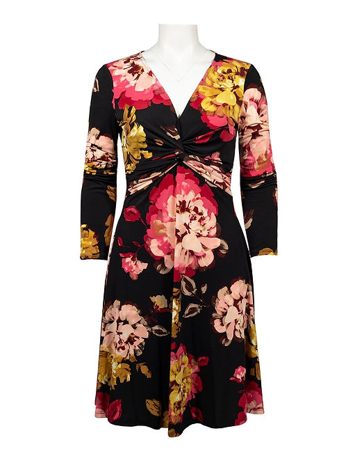 An elegant, vibrant long sleeve jersey knit dress with all-over