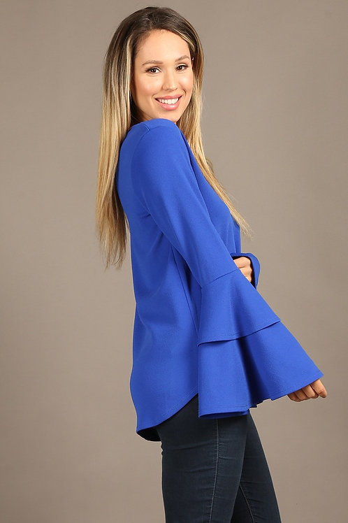 1303 Solid top with a v-neckline, and long double bell sleeves.