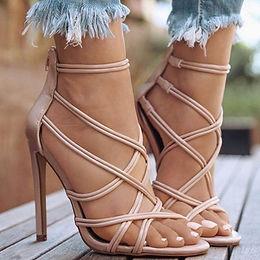 Cross ribbon high heeled sandals.