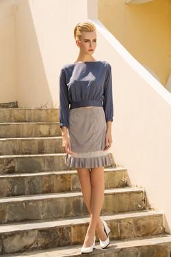 Short tan skirt gray long sleeve blouse