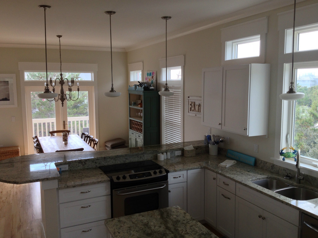 Kitchen opens to living space