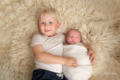Photograph of a newborn baby boy and his proud older brother by Christchurch newborn baby & family photographer Kirsten Naomi Photography