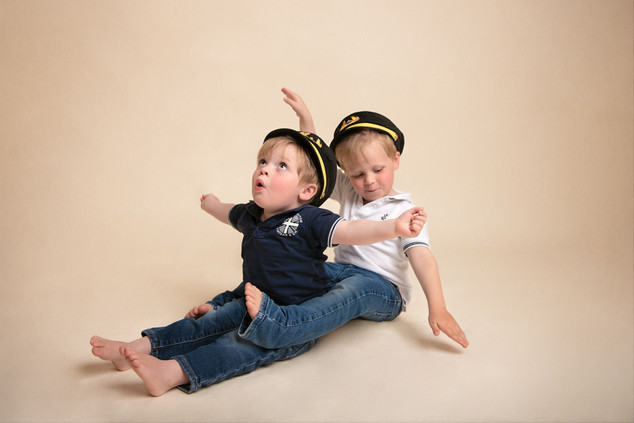 Portrait of two brothers in a pilot hats by Christchurch child and family photographer Kirsten Naomi Photography