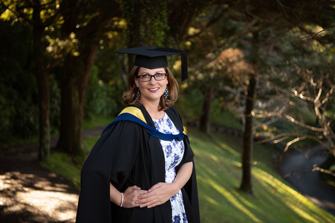 Portrait of an adult graduate in their cap and gown by Christchurch family photographer Kirsten Naomi Photography  | Family Portraits | Lifestyle Photography | Environmental Portraits | Simply Authentic