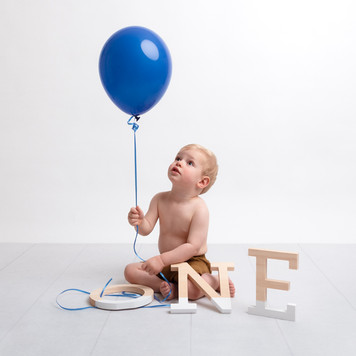 Photograph of a  baby boy on his first birthday by Christchurch newborn baby & family photographer Kirsten Naomi Photography
