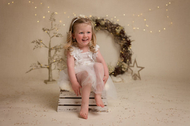Portrait of a small girl in a white lacey dress by Christchurch family photographer Kirsten Naomi Photography
