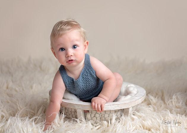 Sitting Baby Boy in Blue Knit Romper 200