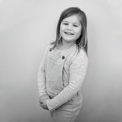 Black and white portrait of a smiling girl by Christchurch family photographer Kirsten Naomi Photography