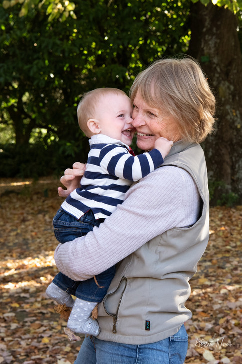 Photograph of a grandmother cuddling her giggling baby grandson by Christchurch family photographer Kirsten Naomi Photography | Family Portraits | Lifestyle Photography | Environmental Portraits | Simply Authentic