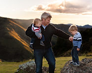 Gorgeous photograph of a father and his young sons in the hills at sunset | Portrait by Christchurch family photographer Kirsten Naomi Photography