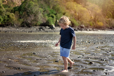 Photograph of a boy walking up a beach by Christchurch family photographer Kirsten Naomi Photography  | Family Portraits | Lifestyle Photography | Environmental Portraits | Simply Authentic