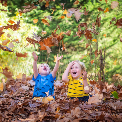 Portrait of two boys playing with Autumn leaves by Christchurch family photographer Kirsten Naomi Photography | Family Portraits | Lifestyle Photography | Environmental Portraits | Simply Authentic