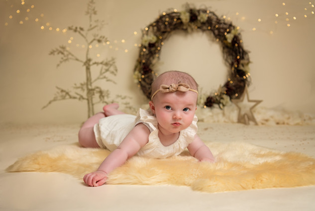 Portrait of a red headed babyPortrait of a baby girl at Christmas by Christchurch Baby and Family Photographer Kirsten Naomi Photography