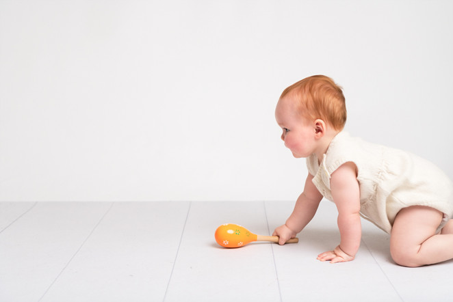 Portrait of a crawling baby by Christchurch Baby and Family Photographer Kirsten Naomi Photography