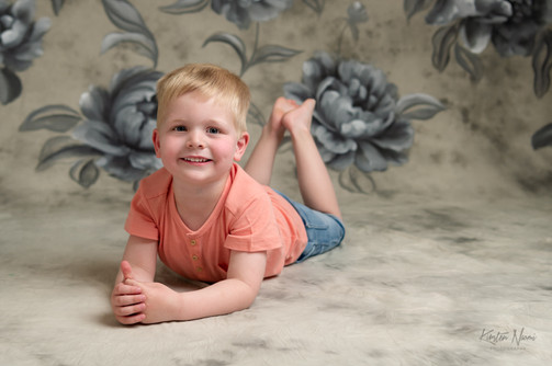 Portrait of a boy lying on his tummy by Christchurch family photographer Kirsten Naomi Photography