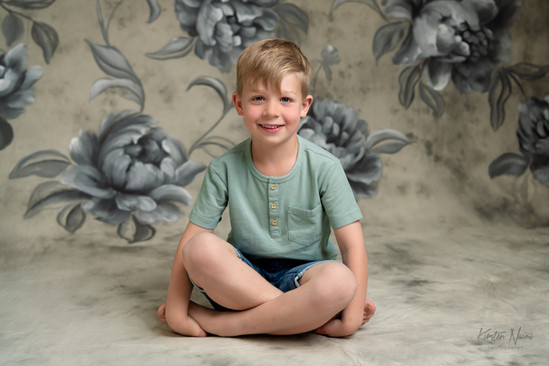 Portrait of a boy with crossed legs by Christchurch family photographer Kirsten Naomi Photography
