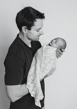 Photograph of a newborn baby boy and his dad by Christchurch newborn baby & family photographer Kirsten Naomi Photography