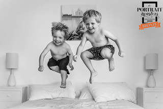 Award winning portrait of two brothers jumping on a bed by Christchurch Children and Family Photographer Kirsten Naomi Photography
