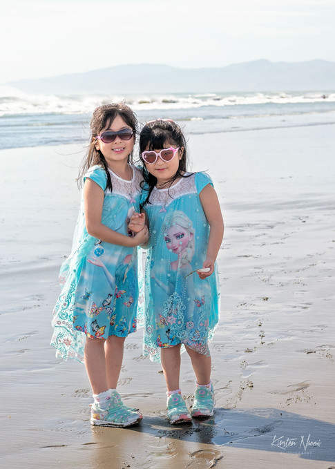 Portrait of a twin sisters on the beach by Christchurch family photographer Kirsten Naomi Photography | Family Portraits | Lifestyle Photography | Environmental Portraits | Simply Authentic