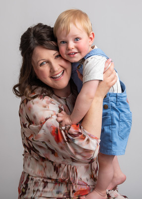 Photograph of a toddler cuddling his mother by Christchurch newborn baby & family photographer Kirsten Naomi Photography