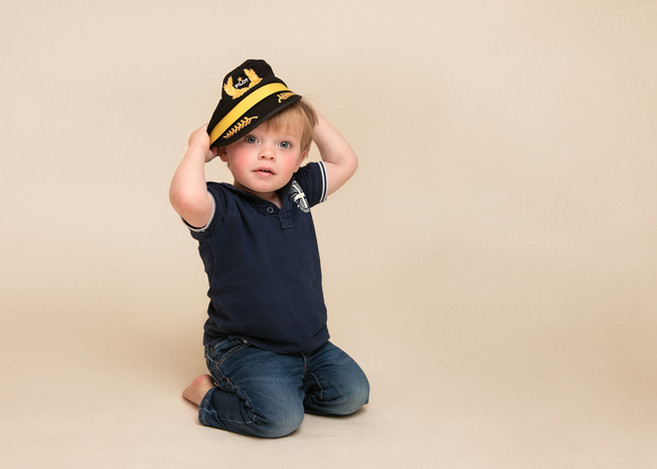 Portrait of a small boy in a pilot hat by Christchurch child and family photographer Kirsten Naomi Photography