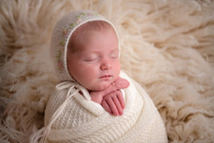 Photograph of a newborn baby girl by Christchurch newborn baby & family photographer Kirsten Naomi Photography