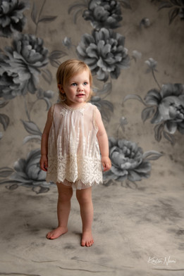 Portrait of a small girl in a vintage lace outfit by Christchurch family photographer Kirsten Naomi Photography