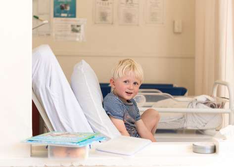 Portrait of a new big brother at Lincoln Materntiy Hospital by Christchurch newborn baby and family photographer Kirsten Naomi Photography
