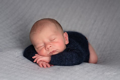 Photograph of a newborn baby boy sleeping peacefully on his tummy by Christchurch newborn baby & family photographer Kirsten Naomi Photography