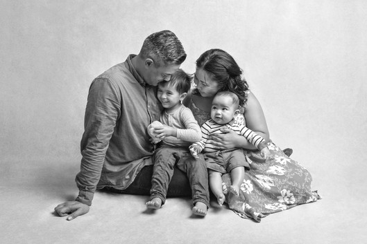 Portrait of a bright eyed 7 month of baby boy and his family by Christchurch Baby and Family Photographer Kirsten Naomi Photography
