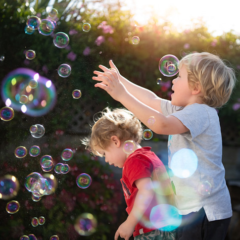 Portrait of two boys playing with bubbles by Christchurch family photographer Kirsten Naomi Photography | Family Portraits | Lifestyle Photography | Environmental Portraits | Simply Authentic