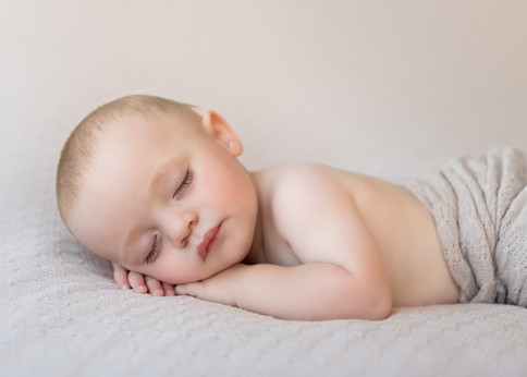 Photograph of a sleeping baby boy with gorgeous eyelashes by Christchurch baby and family photographer Kirsten Naomi Photography