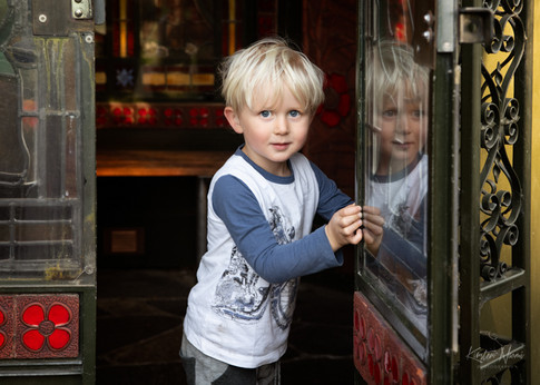 Portrait of a boy looking out of a folly by Christchurch family photographer Kirsten Naomi Photography  | Family Portraits | Lifestyle Photography | Environmental Portraits | Simply Authentic