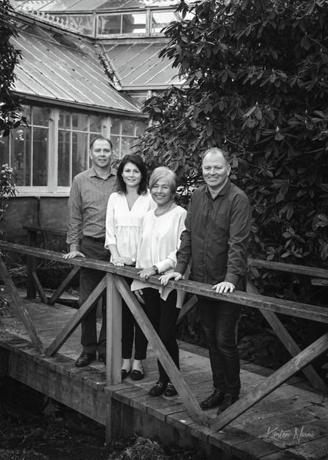 Portrait of an adult family with their Mother in the gardens by Christchurch family photographer Kirsten Naomi Photography   Family Portraits   Lifestyle Photography   Environmental Portraits   Simply Authentic