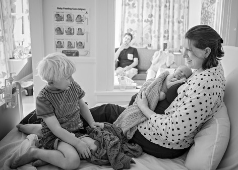 Portrait of a new big brother and his Mum and new baby at Lincoln Materntiy Hospital by Christchurch newborn baby and family photographer Kirsten Naomi Photography