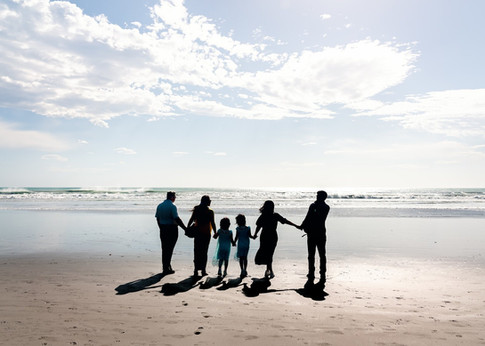 Portrait of a family silhouetted on the beach by Christchurch family photographer Kirsten Naomi Photography | Family Portraits | Lifestyle Photography | Environmental Portraits | Simply Authentic
