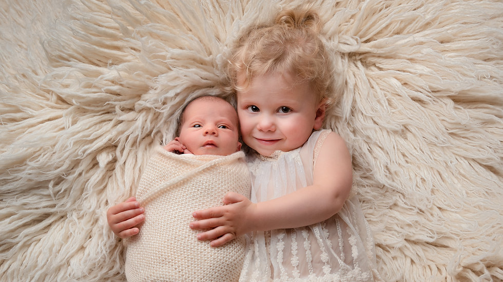 Newborn Baby Girl and her sister cuddling by Christchurch newborn baby photographer Kirsten Naomi Photography.jpg