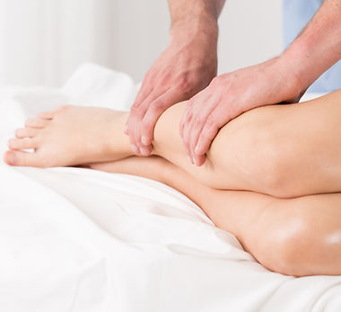 Physical therapist doing lymphatic drainage for the legs.jpg