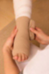A pressure bandage is being applied by a