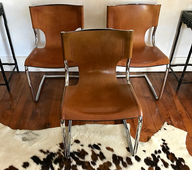 Three Chrome and Leather Cantilever Dining Chairs