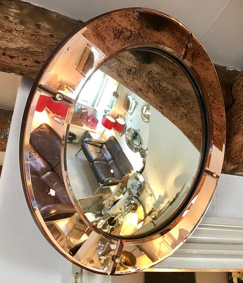 Round Mirror with Peach Mirror Frame.