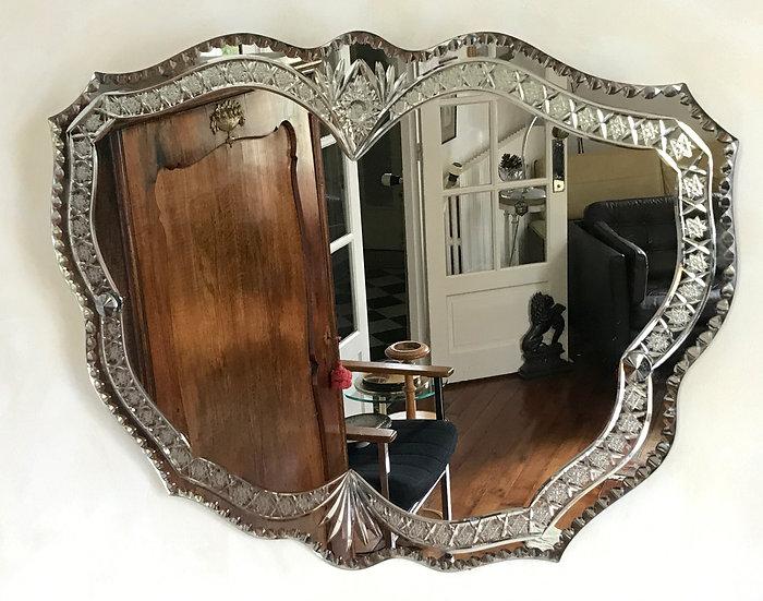 Heavily Cut Butterfly Mirror.