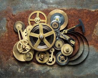 Metal collage of clockwork on rusty back